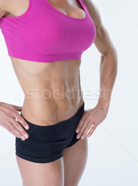 Vrouwelijke bodybuilder poseren handen heupen Stockfoto © wavebreak_media