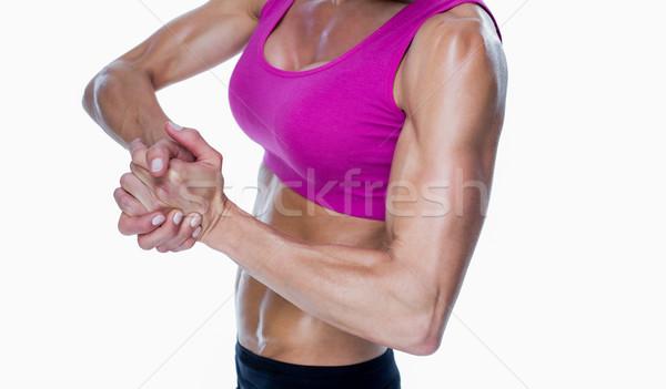 Female bodybuilder posing with hands together Stock photo © wavebreak_media