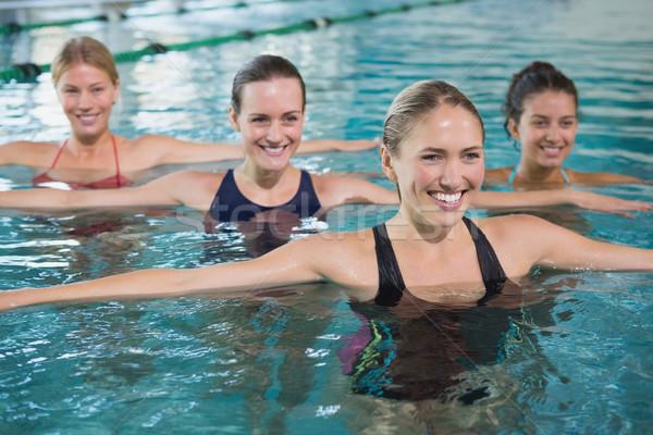 Uśmiechnięty kobiet fitness klasy aerobik Zdjęcia stock © wavebreak_media