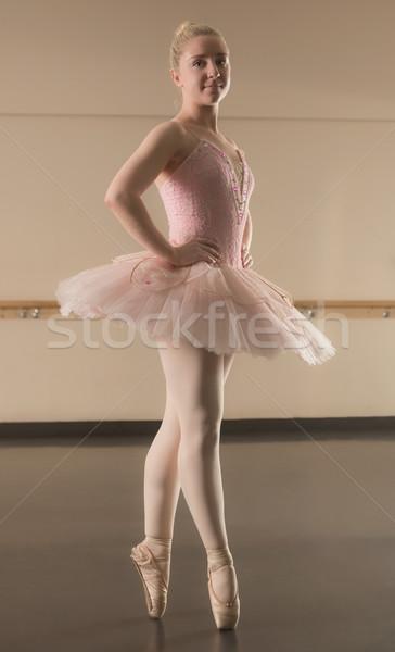 Stock photo: Beautiful ballerina standing en pointe