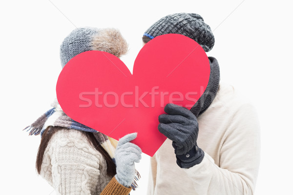 Attractive young couple in warm clothes holding red heart Stock photo © wavebreak_media