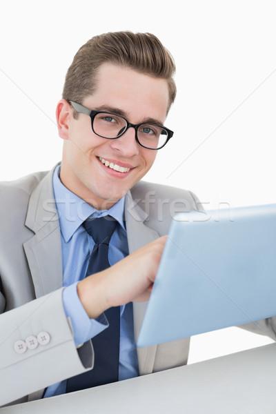 Nerdy businessman working on tablet pc Stock photo © wavebreak_media