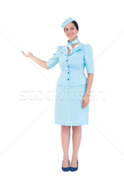 Pretty air hostess showing with hand Stock photo © wavebreak_media