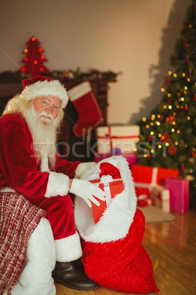 Boldog mikulás harisnya ajándékok otthon nappali Stock fotó © wavebreak_media