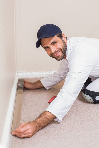 Handyman laying down a carpet Stock photo © wavebreak_media