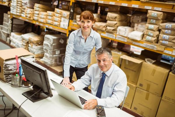 Warehouse managers working together on laptop Stock photo © wavebreak_media