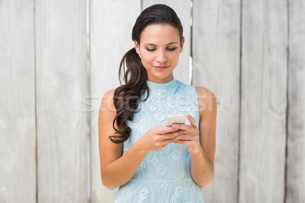 Stylish brunette on the phone Stock photo © wavebreak_media