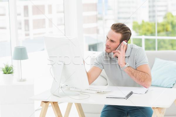 Concentrado empresário telefone escritório telefone Foto stock © wavebreak_media