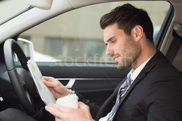молодые бизнесмен чтение карта автомобилей бизнеса Сток-фото © wavebreak_media