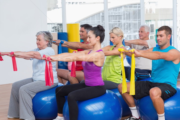 People exercising with resistance bands in gym Stock photo © wavebreak_media
