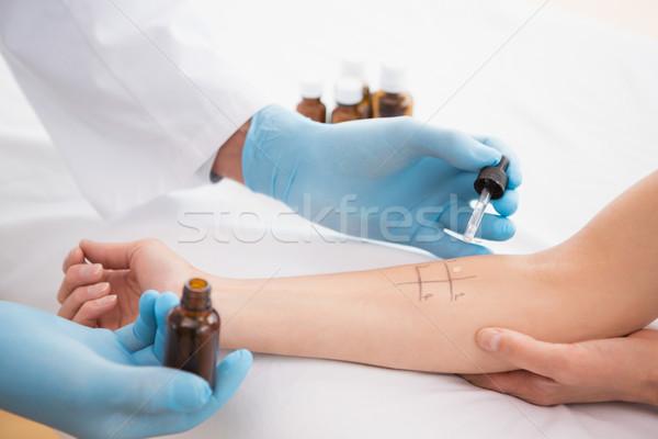 Doctor doing skin prick test at his patient  Stock photo © wavebreak_media