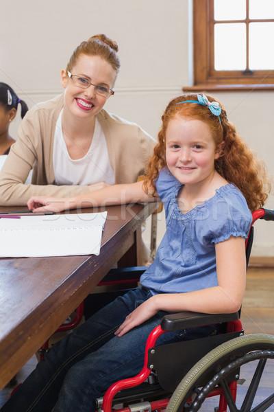 довольно учитель помогают классе девушки Сток-фото © wavebreak_media