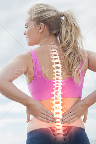 Highlighted spine of woman with back pain Stock photo © wavebreak_media