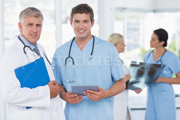 команда улыбаясь врачи медицинской служба Сток-фото © wavebreak_media
