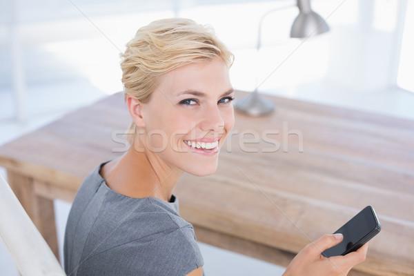 笑みを浮かべて 女性実業家 送信 文字 デスク オフィス ストックフォト © wavebreak_media