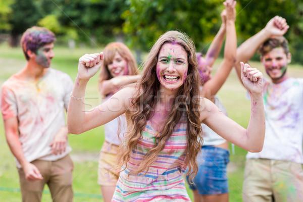Happy friends covered in powder paint Stock photo © wavebreak_media