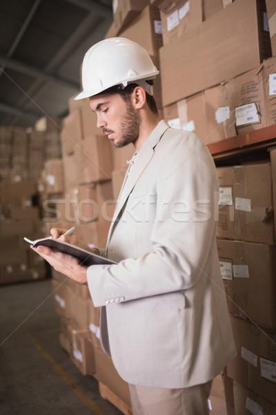 Manager dagboek magazijn permanente dozen man Stockfoto © wavebreak_media