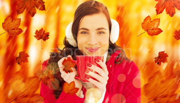 Composite image of woman in winter clothes enjoying a hot drink Stock photo © wavebreak_media