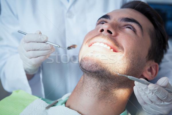 Close up of man having his teeth examined Stock photo © wavebreak_media