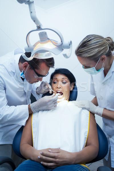 Dentista assistente denti maschio dentisti Foto d'archivio © wavebreak_media