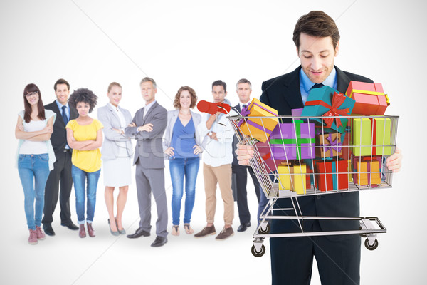 Composite image of businessman holding something with his hands Stock photo © wavebreak_media