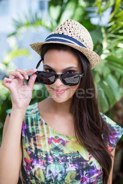 Sorridente belo morena chapéu de palha sol Foto stock © wavebreak_media