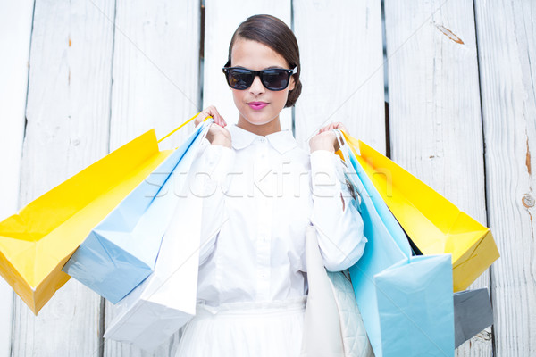 Pretty brunette holding shopping bags Stock photo © wavebreak_media