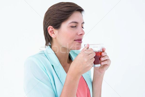 мирный женщину питьевой Кубок чай белый Сток-фото © wavebreak_media