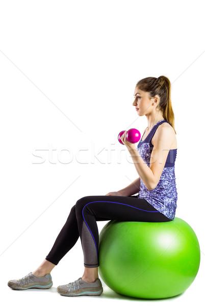 Fitt nő emel súlyzó ül labda Stock fotó © wavebreak_media