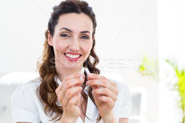 Woman snapping her cigarette Stock photo © wavebreak_media