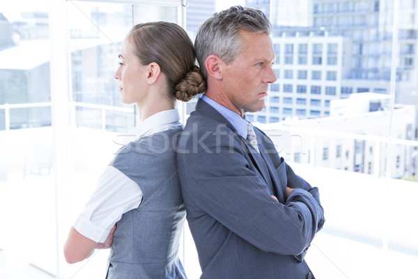 Two angry business colleagues standing back to back Stock photo © wavebreak_media