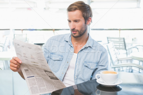Young man reading the newspapers Stock photo © wavebreak_media