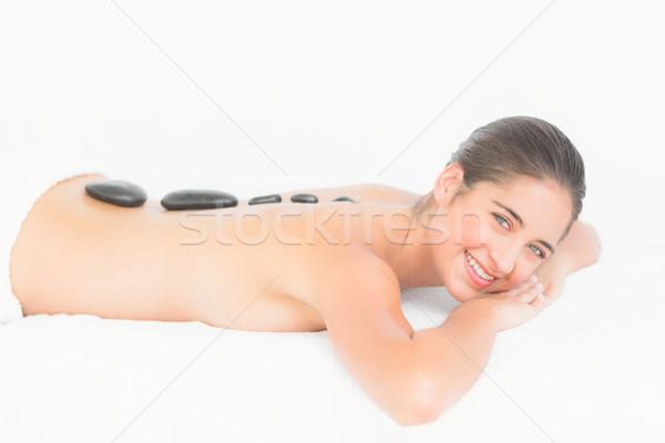 Beautiful brunette enjoying a hot stone massage  Stock photo © wavebreak_media