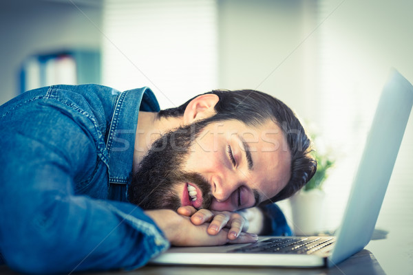 Hipster businessman sleeping at his desk Stock photo © wavebreak_media