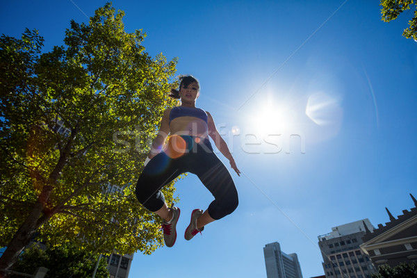 Low angle view of athletic woman jumping in the air Stock photo © wavebreak_media