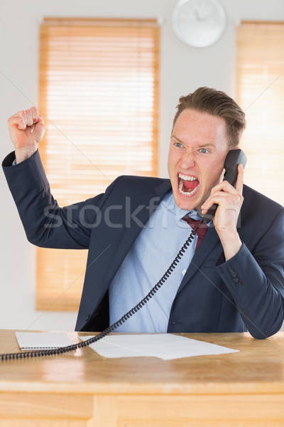 Furious businessman outraged on the phone Stock photo © wavebreak_media