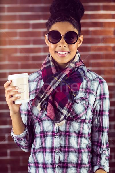 Vrouwelijke beker koffie muur Stockfoto © wavebreak_media