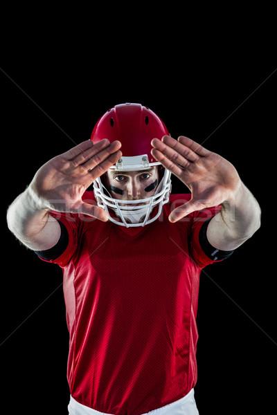 Portrait of american football player protecting himself  Stock photo © wavebreak_media