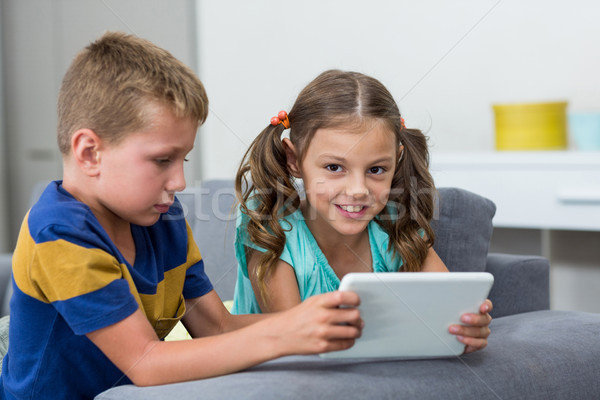 Siblings using digital tablet in living room Stock photo © wavebreak_media