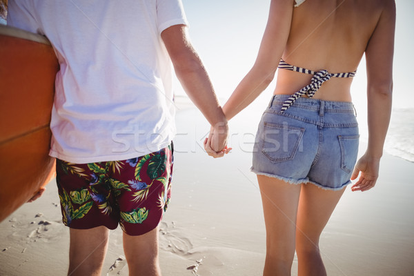 Mid section of couple holding hands at beach Stock photo © wavebreak_media