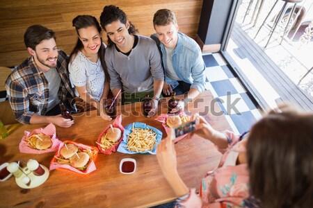 Friends discussing over laptop Stock photo © wavebreak_media