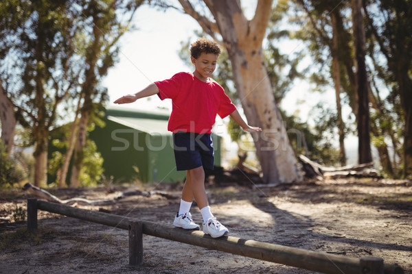 Happy boy exercising on obstacle during obstacle course Stock photo © wavebreak_media
