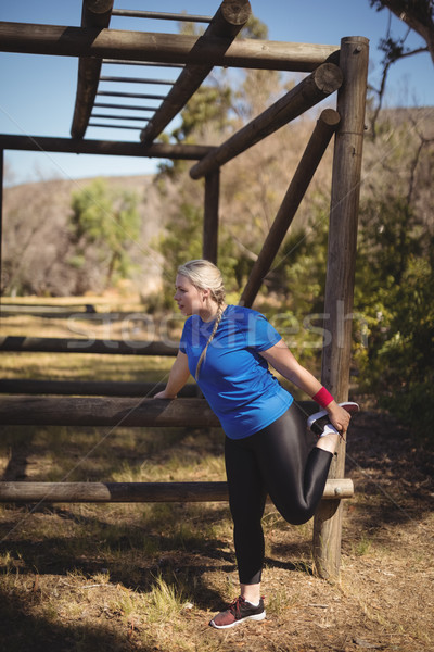Beautiful woman exercising during obstacle course Stock photo © wavebreak_media