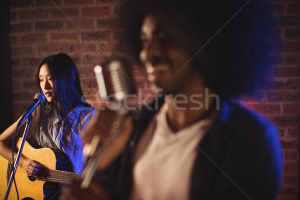 Male singer with female guitarist in nightclub Stock photo © wavebreak_media