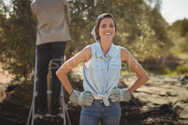 Smiling woman with man in background at olive farm Stock photo © wavebreak_media