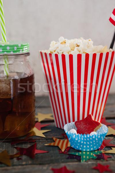 ポップコーン 製菓 ドリンク 木製のテーブル 紙 ストックフォト © wavebreak_media