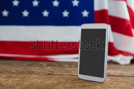 American flag and digital tablet arranged on wooden table Stock photo © wavebreak_media