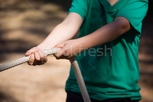 Boy practicing tug of war during obstacle course training in the boot camp Stock photo © wavebreak_media