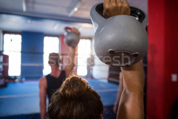 Widok z tyłu kobiet sportowiec czajnik fitness Zdjęcia stock © wavebreak_media
