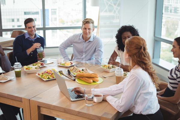 Business colleagues discussing while sitting around breakfast table Stock photo © wavebreak_media